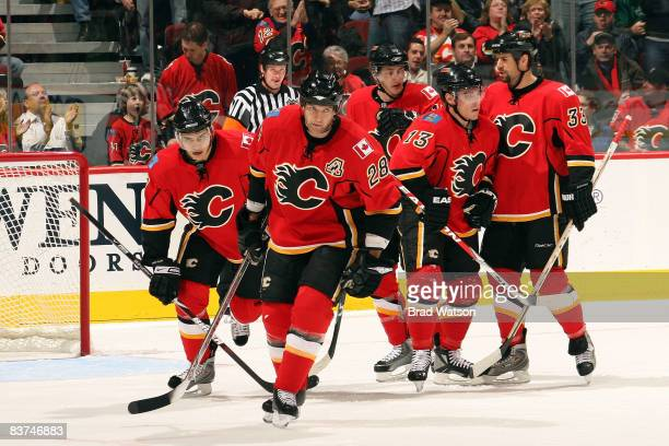 Robyn Regehr and teammates of the Calgary Flames celebrate a goal against the Colorado Avalanche on November 18 2008 at Pengrowth Saddledome in...