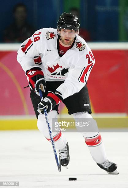 Robyn Regehr of Canada controls the puck during their quarter final of the men's ice hockey match against Russia during Day 12 of the Turin 2006...