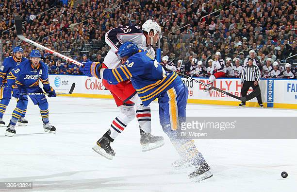 Robyn Regehr of the Buffalo Sabres blocks the path of Alexandre Giroux of the Columbus Blue Jackets at First Niagara Center on October 27, 2011 in...
