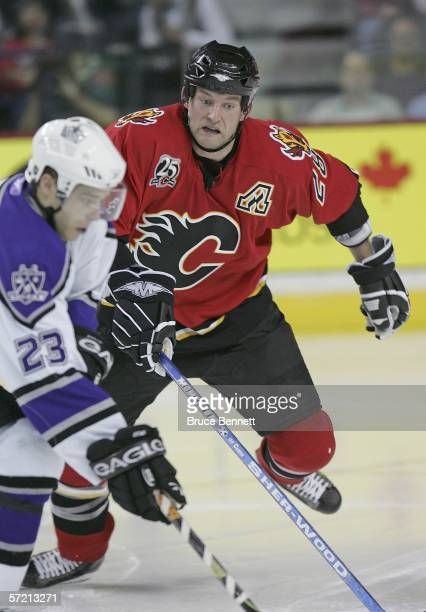 Robyn Regehr of the Calgary Flames defends against Dustin Brown of the Los Angeles Kings on March 29 2006 at the Pengrowth Saddledome in Calgary...