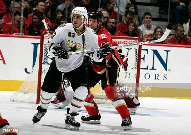 Robyn Regehr of the Calgary Flames defends the zone against Mike Ribeiro of the Dallas Stars on December 21, 2007 at Pengrowth Saddledome in Calgary,...