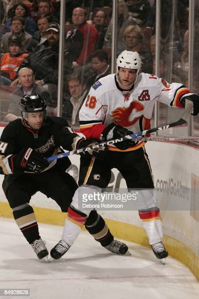 Robyn Regehr of the Calgary Flames fights for position against Rob Niedermayer of the Anaheim Ducks during the game on February 11 2009 at Honda...