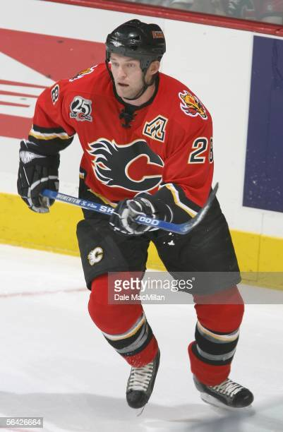 Robyn Regehr of the Calgary Flames skates against the Ottawa Senators during the NHL game at Pengrowth Saddledome on December 10 2005 in Calgary...
