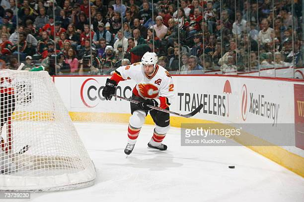 Robyn Regehr of the Calgary Flames skates for the puck against the Minnesota Wild during the game at Xcel Energy Center on March 27, 2007 in Saint...