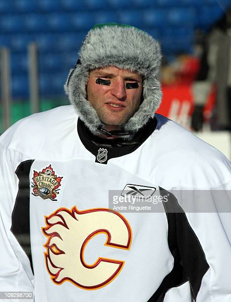 Robyn Regehr of the Calgary Flames sports a Saskatchewan Roughriders hat during the practice session the day before the 2011 NHL Heritage Classic at...