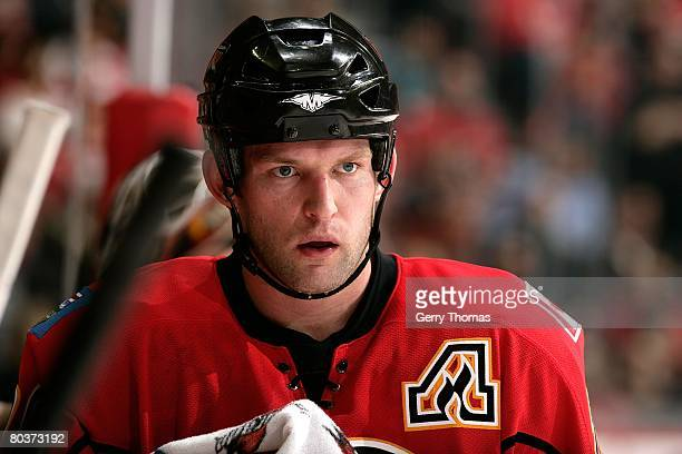 Robyn Regehr of the Calgary Flames takes a break by the bench during a stoppage in play against the Minnesota Wild on March 22, 2008 at Pengrowth...