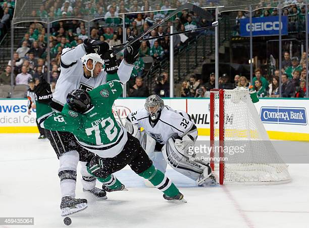 Robyn Regehr of the Los Angeles Kings checks Erik Cole of the Dallas Stars in the third period at American Airlines Center on November 22, 2014 in...