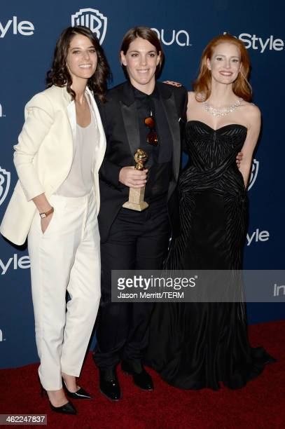 Robyn Shapiro producer Megan Ellison winner of Best Motion Picture Musical or Comedy for 'American Hustle' and actress Jessica Chastain attend the...