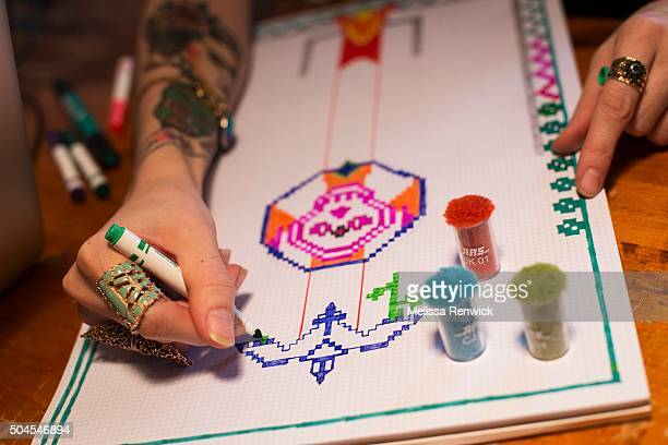 TORONTO ON OCTOBER 20 Robyn Waffle works on hand drawn pixel art that will eventually be turned into a rug