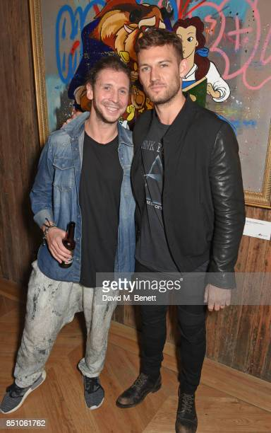 Robyn Ward and Alex Pettyfer attend a private view of new exhibition 'A Simpler Time ' by artist Robyn Ward at the Old Chappell Piano Factory on...
