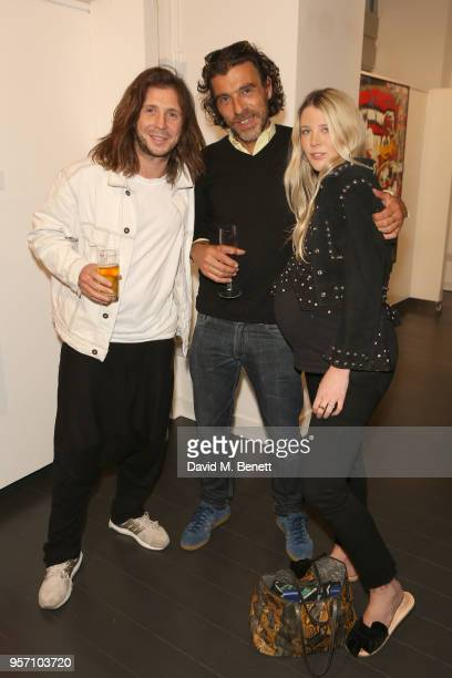 Robyn Ward Derrick Santini and Gracie Egan attend Once Upon A Time by contemporary Irish street artist Robyn Ward on May 10 2018 in London England