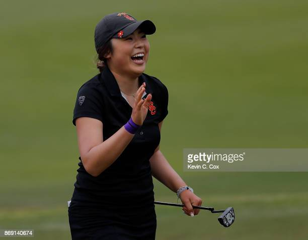 Robynn Ree of the USC Trojans reacts after defeating Shannon Aubert of the Stanford Cardinal on the 18th green during day three of the 2017 East Lake...