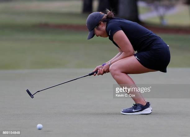 Robynn Ree of the USC Trojans reats after missing her putt on the 17th green during day three of the 2017 East Lake Cup at East Lake Golf Club on...