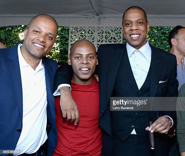 Roc Nation's Jay Brown Tyran 'Tata' Smith and rapper/producer JayZ attend the Roc Nation PreGRAMMY Brunch Presented by MAC Viva Glam at Private...