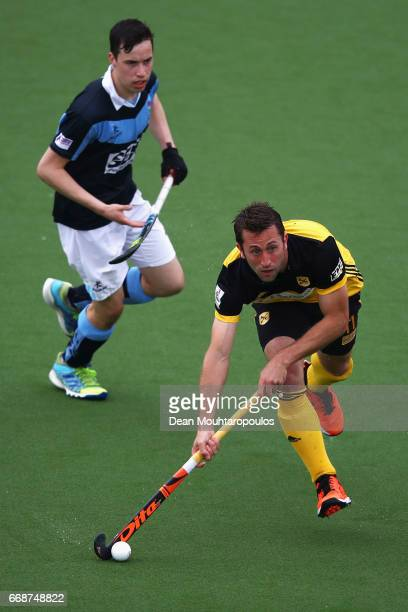 Roc Oliva of Atletic Terrassa HC gets past the tackle from Sean Murray of Lisnagarvey during the Euro Hockey League KO16 match between Atletic...