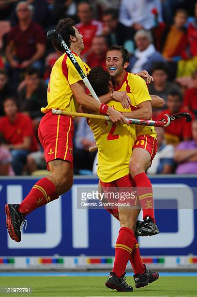 Roc Oliva of Spain celebrates with team mates after scoring his team's opening goal during the Men´s EuroHockey Championships 2011 Pool A match...