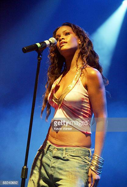 RocAFella recording artist Rihanna performs at the Teen People Listening Lounge hosted by Jay Z at the Key Club on July 14 2005 in West Hollywood...