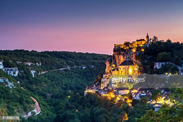 rocamadur at colorful sunset - famous historic city in southwest france - rocamadour stock pictures, royalty-free photos & images