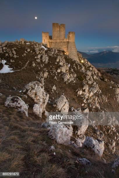 Rocca Calascio fortress with moon back, Abruzzo region, Italy