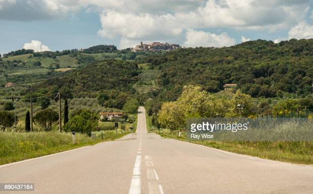 roccastrada from middle of the road in tuscany, italy. - mid section stock photos and pictures