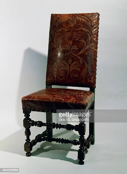 Rocchetto chair with seat and back upholstered with embossed leather Italy 17th century