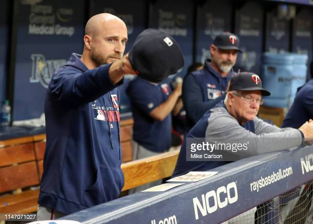 Rocco Baldelli of the Minnesota Twins acknowledges the Tampa Bay Rays dugout during a tribute to his time as a player for the team during a baseball...