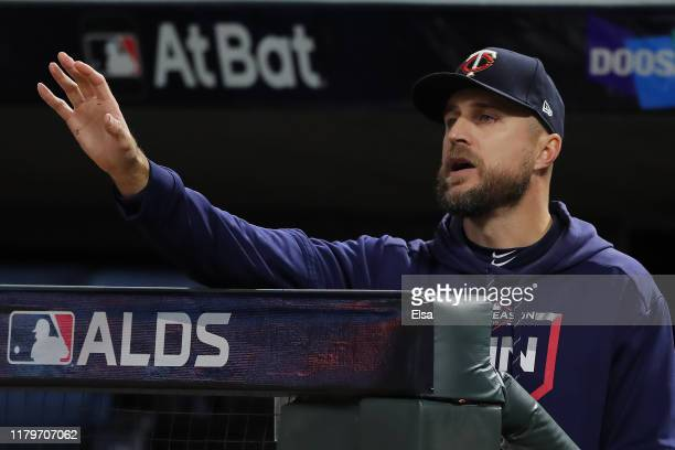 Rocco Baldelli of the Minnesota Twins challenges a call in game three of the American League Division Series against the New York Yankees at Target...