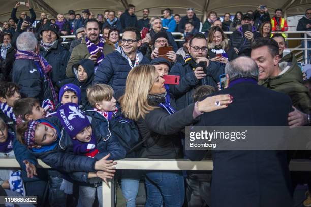 Rocco Commisso chief executive officer and founder of Mediacom Communications Corp greets fans on the soccer pitch after the ACF Fiorentina v SPAL...