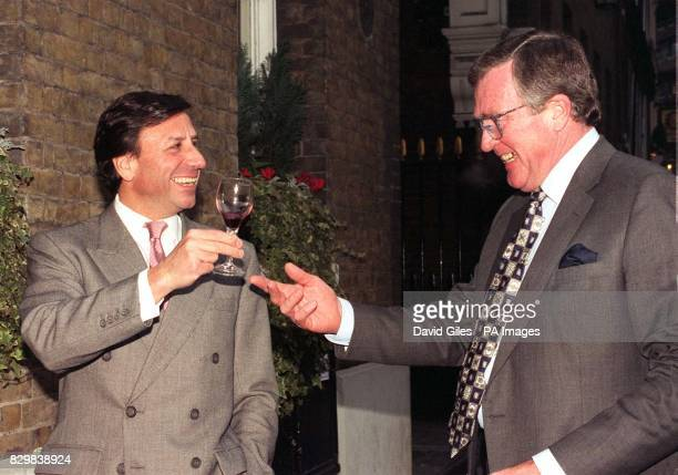 Rocco Forte Chairman of Forte plc toasts Peter Jarvis chief Executive of Whitbread after announcing they have entered into a conditional agreement...