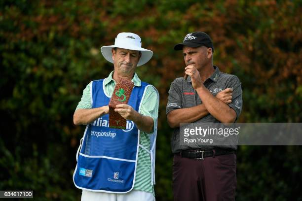 Rocco Mediate and his caddy discuss their tee shot on the 16th hole during the first round of the PGA TOUR Champions Allianz Championship at The Old...