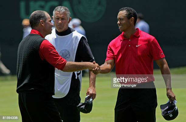 Rocco Mediate and Tiger Woods shake hands on the 18th green as they played to a tie at the end of the playoff round of the 108th US Open at the...