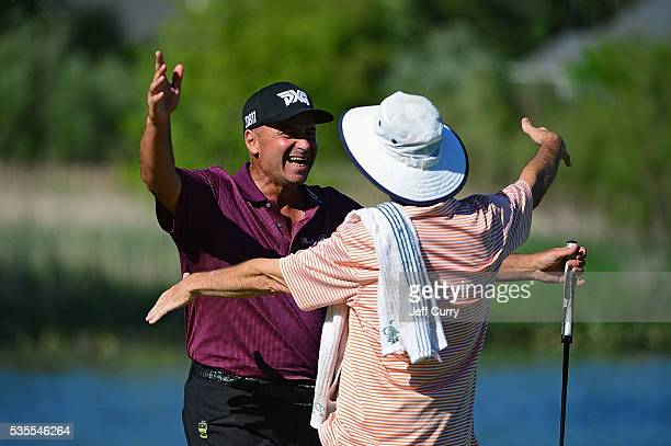 Rocco Mediate celebrates with his caddy after winning the 2016 Senior PGA Championship presented by KitchenAid at the Golf Club at Harbor Shores on...