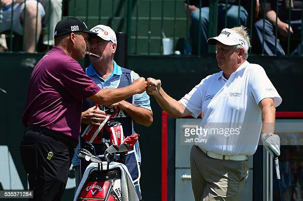 Rocco Mediate greets Colin Montgomerie of Scotland prior to teeing off on the first hole during the final round of the 2016 Senior PGA Championship...