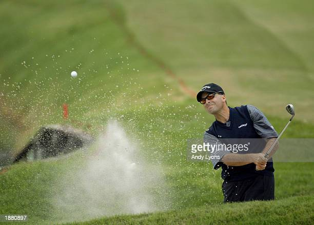 Rocco Mediate hits his 3rd shot on the par 5 16th hole during the Players Championship at the TPC at Sawgrass Stadium Course on March 27 2003 in...