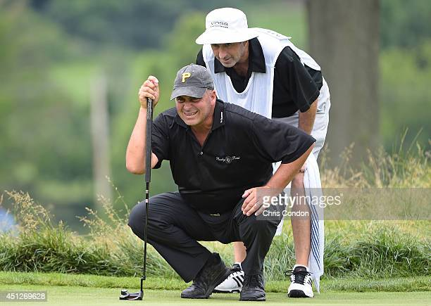 Rocco Mediate ines up a putt on the 7th green during the first round of the Constellation SENIOR PLAYERS Championship at Fox Chapel Golf Club on June...