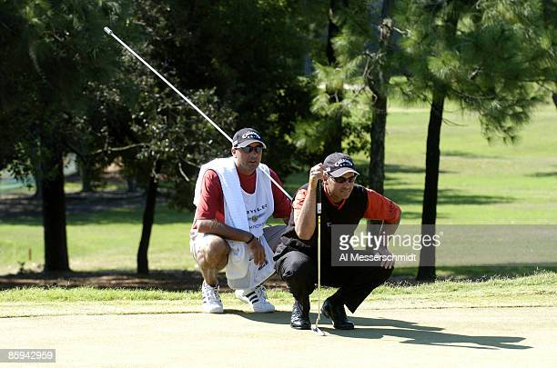 Rocco Mediate lines up a putt on the first hole during the final round of the 2005 Chrysler Championship October 30 in Palm Harbor