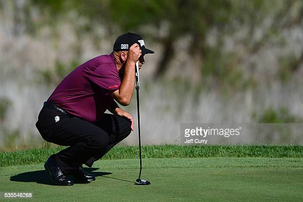 Rocco Mediate lines up his putt on the 16th green during the final round of the 2016 Senior PGA Championship presented by KitchenAid at the Golf Club...