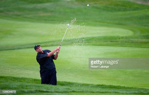 Rocco Mediate makes a shot out of a bunker on the first hole during the final round of the Fryscom Open at the CordeValle Golf Club on October 17...