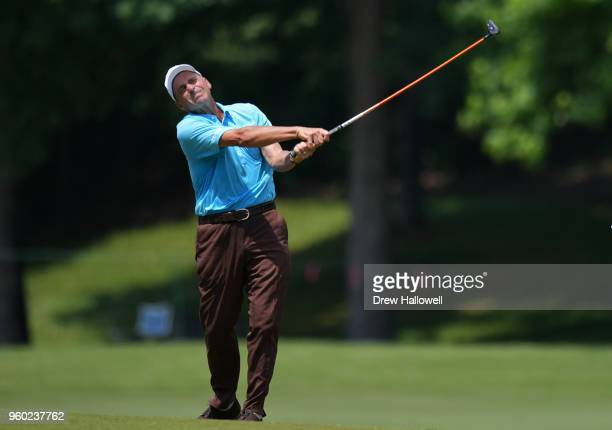 Rocco Mediate of the United States plays a shot on the 18th hole during the third round of the Regions Tradition at Greystone Golf Country Club on...