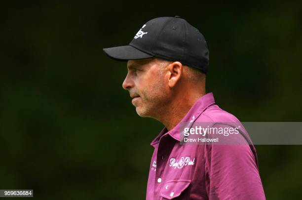 Rocco Mediate of the United States watches play from the fifth hole during the first round of the Regions Tradition on May 17 2018 in Birmingham...