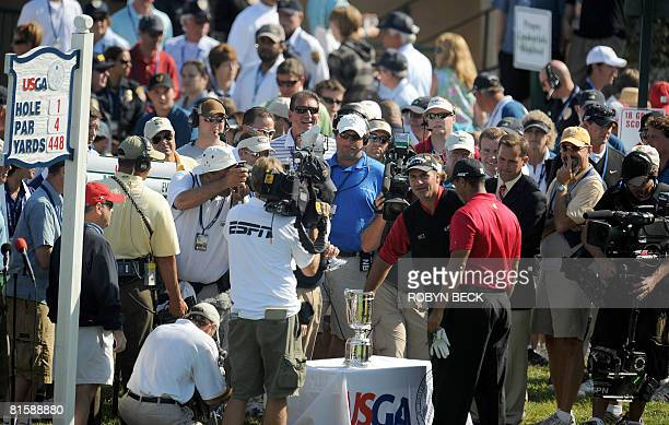 Rocco Mediate of the US draws the first shooting position as Tiger Woods of the US looks on before tee off on the first hole in their playoff at the...