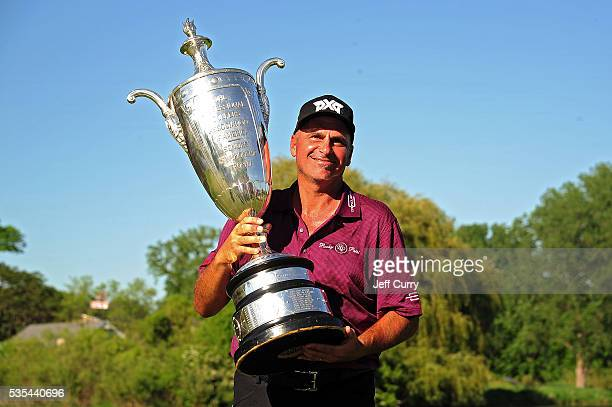 Rocco Mediate poses with the Alfred S Bourne Trophy after winning the 2016 Senior PGA Championship presented by KitchenAid at the Golf Club at Harbor...