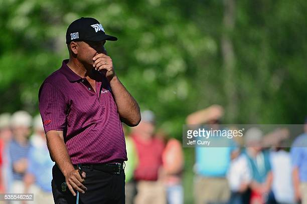 Rocco Mediate reacts to his shot from the 16th fairway during the final round of the 2016 Senior PGA Championship presented by KitchenAid at the Golf...