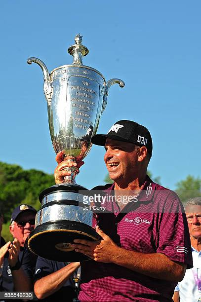 Rocco Mediate receives the Alfred S Bourne Trophy after winning the 2016 Senior PGA Championship presented by KitchenAid at the Golf Club at Harbor...