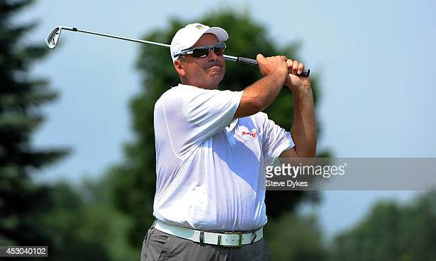Rocco Mediate waits for his fellow golfers to hiit their drive on the fourth hole during the first round of the 3M Championship at TPC Twin Cities on...