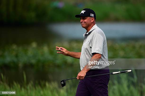 Rocco Mediate waves to fans as he walks to the 18th green during the third round of the 2016 Senior PGA Championship presented by KitchenAid at the...