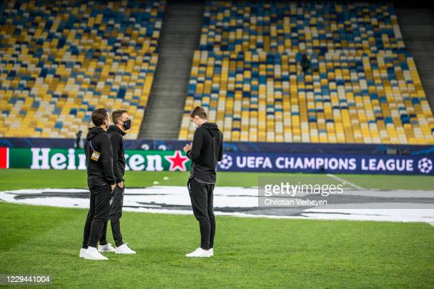 Rocco Reitz Patrick Herrmann and Florian Neuhaus of Borussia Moenchengladbach are seen on the pitch before the Group B UEFA Champions League match...