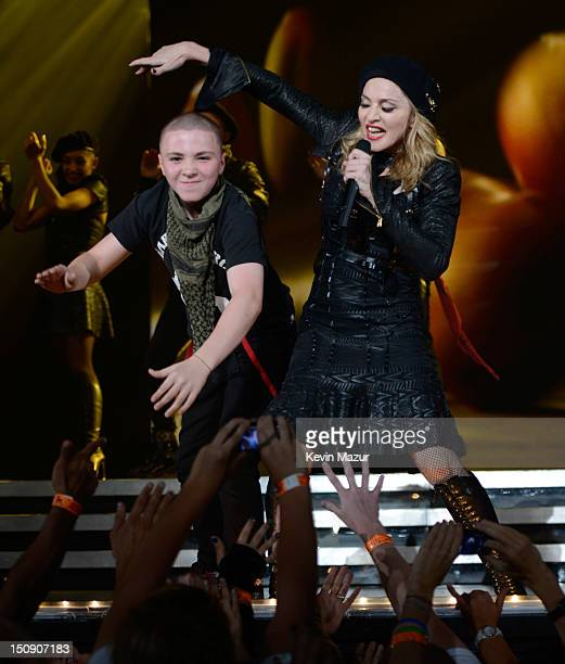 Rocco Ritchie and Madonna perform during the MDNA North America tour opener at the Wells Fargo Center on August 28 2012 in Philadelphia Pennsylvania