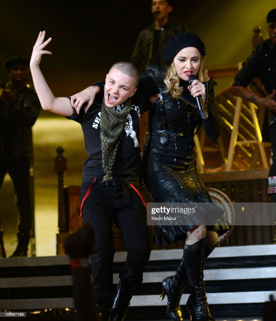 Rocco Ritchie and Madonna perform during the MDNA North America tour opener at the Wells Fargo Center on August 28, 2012 in Philadelphia, Pennsylvania.
