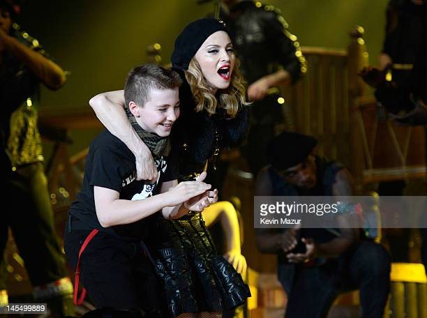Rocco Ritchie and Madonna perform on stage during her 'MDNA' tour at Ramat Gan Stadium on May 31 2012 in Tel Aviv Israel